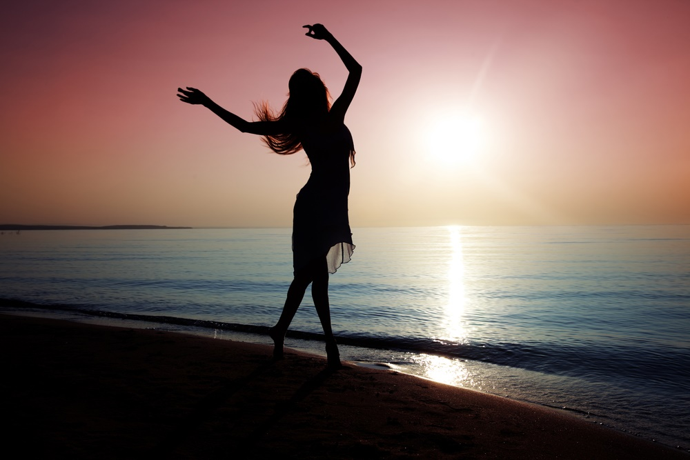 dancing lady sillouette on beach sunset.jpg
